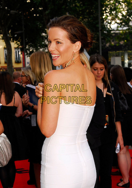 "KATE BECKINSALE .UK premiere of ""Die Hard 4.0: Live Free or Die Hard"" at the Empire Leicester Square, London, England..June 20th, 2007.white strapless dress back behind gold earrings half length .CAP/IA.©Ian Allis/Capital Pictures"