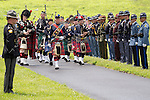 Bagpipes led the processional in to the cemetery as Kentucky State Trooper Eric Keith Chrisman was laid to rest Monday June 29, 2015 in Lawrenceburg, Ky.  He died in the the line of duty June 23, 2015.  Police officers and Fire fighters from across Kentucky and the Nation came to pay respects to his family.  Photo by Mark Mahan