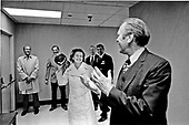 First lady Betty Ford winds up to toss a football to her husband, United States President Gerald R. Ford, at the Bethesda Naval Hospital in Bethesda, Maryland on October 4, 1974.  The football was a game ball from Monday's Washington Redskins game and was presented to Mrs. Ford by the team.  In the background on the left is Doctor William Lukash, the President's doctor.  On his left is Doctor William Fouty, Chairman of Surgery at Bethesda and the doctor who performed the operation on Mrs. Ford.  Mrs. Ford is in the hospital recovering from cancer surgery.<br /> Mandatory Credit: David Hume Kennerly / White House via CNP