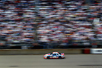 Richard Petty drives past the main grandstand during a 1992 NASCAR race at Michigan International Speedway near Brooklyn, Michigan.