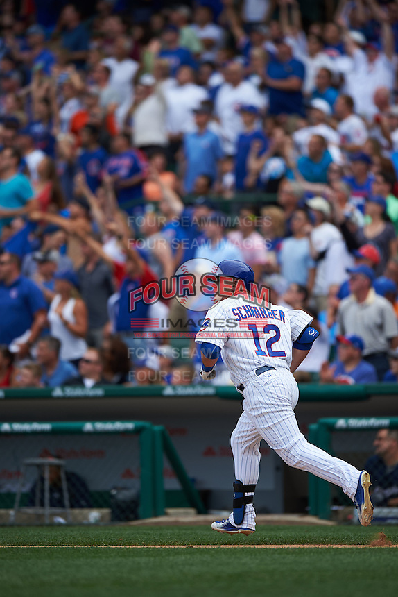 Chicago Cubs outfielder Kyle Schwarber (12) hits a home run during a game against the Milwaukee Brewers on August 13, 2015 at Wrigley Field in Chicago, Illinois.  Chicago defeated Milwaukee 9-2.  (Mike Janes/Four Seam Images)
