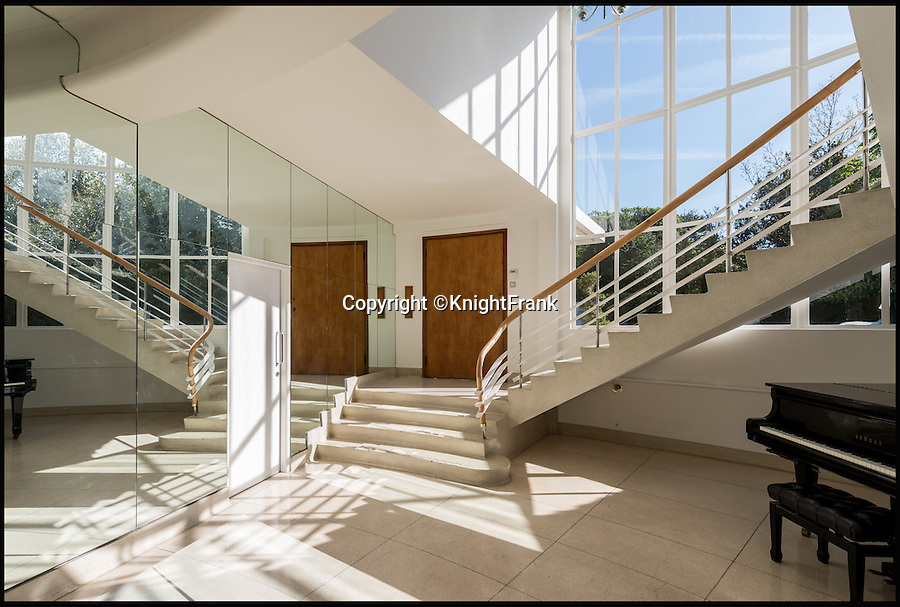 BNPS.co.uk (01202 558833)<br /> Pic: KnightFrank/BNPS<br /> <br /> A sound investment...<br /> <br /> A stunning modernist house where Roxy Music recorded some of their biggest hits, fictional detective Poirot solved crimes and pop band Girls Aloud advertised Nintendo has gone on the market for a whopping £9million.<br /> <br /> The impressive St Ann's Court is an incredible two-for-one deal with a beautiful 1930s 'Round House' and a converted 19th century Coach House that includes a world-class recording studio.<br /> <br /> As well as hosting musicians including Paul Weller and Pink Floyd's David Gilmour, the property near Chertsey in Surrey has featured in countless books, magazines and films.<br /> <br /> The house is being sold by joint agents Knight Frank and The Modern House.