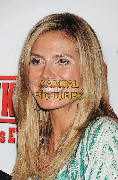 "HEIDI KLUM.""Hoodwinked Too! Hood Vs Evil"" Los Angeles Premiere held at the Pacific Theatre at The Grove,  Los Angeles, California, USA, 16th April 2011..portrait headshot smiling green and white  print top  hoop earrings .CAP/ROT/TM.© TM/Roth/Capital Pictures"