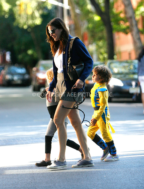 WWW.ACEPIXS.COM . . . . .  ....September 5 2010, New York City....Actress Liv Tyler was seen walking with her son Milo (in the Batman outfit) and some friends near her West Village home on September 5 2010 in New York City.....Please byline: NANCY RIVERA- ACEPIXS.COM.... *** ***..Ace Pictures, Inc:  ..Tel: 646 769 0430..e-mail: info@acepixs.com..web: http://www.acepixs.com