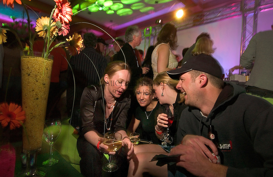 From the left, Cara Thomas, Alex Steel, Beth Slater, and Stefan Davidson enjoy a private party at the Sky Hotel's 39 Degrees bar in Aspen, CO Friday night. © Michael Brands.