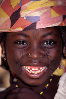 Maraka, Niger, Africa - Hausa Girl with Facial Scarification to Denote Tribal Affiliation.  A Piece of Straw in the Nostril Holds the Place for a Nose Ring.