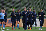 22 April 2008: Hope Solo (center) leads her teammates around the field as the team warms up. The United States Women's National Team held a training session on Field 3 at WakeMed Soccer Park in Cary, NC.