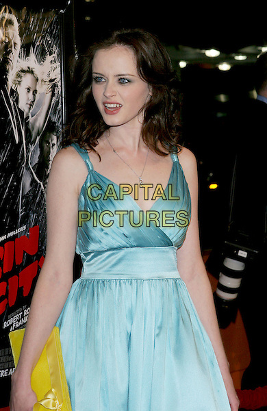 "ALEXIS BLEDEL.""Sin City"" World Premiere held at Mann National Theater, Westwood, Los Angeles, California, USA, .March 28th 2005..half length blue dress yellow clutch bag purse.Ref: ADM.www.capitalpictures.com.sales@capitalpictures.com.©Jacqui Wong/AdMedia/Capital Pictures."