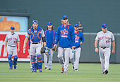 New York Mets pitchers and catchers, led by starting pitcher Noah Syndergaard (34) walk from the bullpen to the dugout prior to the game against the Baltimore Orioles at Oriole Park at Camden Yards in Baltimore, Maryland on Wednesday, August 19, 2015.  The Orioles won the game 5 - 4. Pictured, left to right: Mets bullpen catcher Dave Racaniello (53), catcher Travis d'Arnaud (7), starting pitcher Jacob deGrom (48), Syndergaard, starting pitcher Matt Harvey (33), and pitching coach Dan Warthen (59).<br /> Credit: Ron Sachs / CNP<br /> (RESTRICTION: NO New York or New Jersey Newspapers or newspapers within a 75 mile radius of New York City)