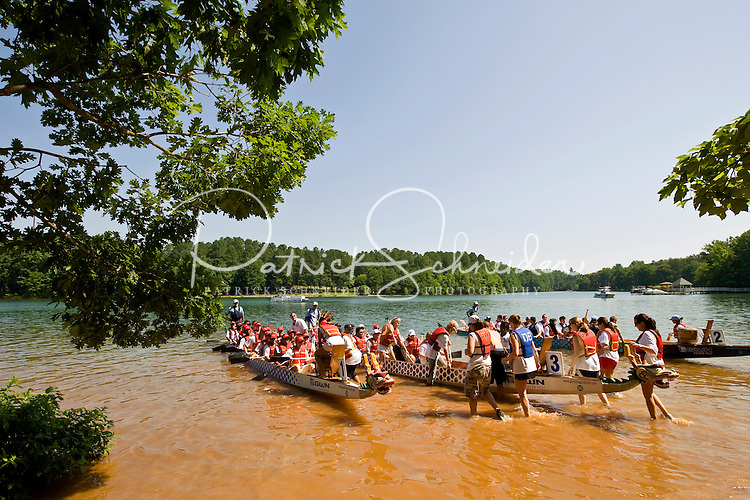 Riders prepare to launch their boat during the Charlotte Dragonboat Association racing on Lake Norman in NC.