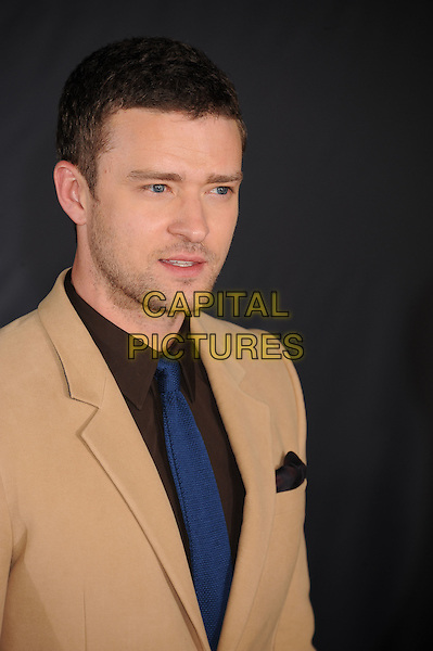 Justin Timberlake.The Regency Enterprises L.A. Premiere of 'In Time' held at The Regency Village Theatre in Westwood, California, USA..October 20th, 2011.headshot portrait brown blue beige stubble facial hair .CAP/ROT/TM.© TM/Roth/Capital Pictures