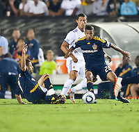 Galaxy defender Sean Franklin (28) shields the ball from Real midfielder Cristiano Ronaldo (7) during the second half of the friendly game between LA Galaxy and Real Madrid at the Rose Bowl in Pasadena, CA, on August 7, 2010. LA Galaxy 2, Real Madrid 3.