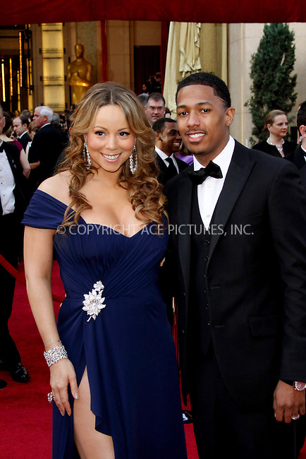 WWW.ACEPIXS.COM . . . . .  ....March 7 2010, Hollywood, CA....Mariah Carey and husband Nick Cannon at the 82nd Annual Academy Awards held at Kodak Theatre on March 7, 2010 in Hollywood, California.....Please byline: Z10-ACE PICTURES... . . . .  ....Ace Pictures, Inc:  ..Tel: (212) 243-8787..e-mail: info@acepixs.com..web: http://www.acepixs.com