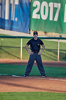 First base umpire Matt Herrera handles the calls on the bases during a game between the Ogden Raptors and the Grand Junction Rockies at Lindquist Field on September 7, 2018 in Ogden, Utah. The Rockies defeated the Raptors 8-5. (Stephen Smith/Four Seam Images)