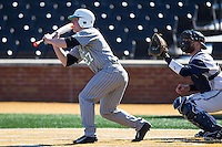 Brenden Wells (27) of the Marshall Thundering Herd squares to bunt against the Georgetown Hoyas at Wake Forest Baseball Park on February 15, 2014 in Winston-Salem, North Carolina.  The Thundering Herd defeated the Hoyas 5-1.  (Brian Westerholt/Four Seam Images)