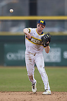 Michigan Wolverines shortstop Travis Maezes (9) makes a throw to first base during the NCAA baseball game against the Washington Huskies on February 16, 2014 at Bobcat Ballpark in San Marcos, Texas. The game went eight innings, before travel curfew ended the contest in a 7-7 tie. (Andrew Woolley/Four Seam Images)