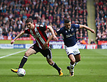 Chris Basham of Sheffield Utd tussles with James Meredith of Millwall during the championship match at the Bramall Lane Stadium, Sheffield. Picture date 14th April 2018. Picture credit should read: Simon Bellis/Sportimage