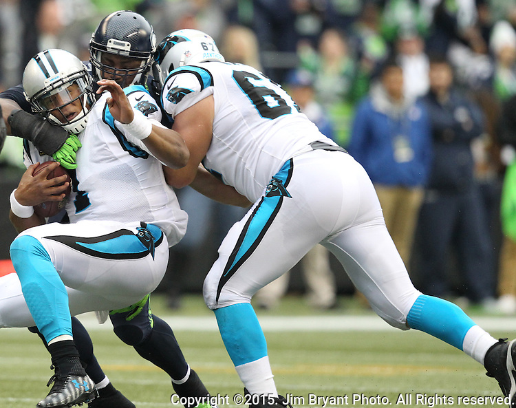 Seattle Seahawks linebacker Bruce Irvin sacks  Carolina Panthers quarterback Kam Chancellor (1) at CenturyLink Field in Seattle on October 18, 2015. The Panthers came from behind with 32 seconds remaining in the 4th Quarter to beat the Seahawks 27-23.  ©2015 Jim Bryant Photography. All Rights Reserved.