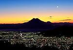 San Vincente Volcano rises above the city lights of San Salvador, El Salvador.