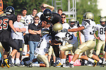 Beverly Hills, CA 09/23/11 - Rory Hubbard (Peninsula #33), Alex Asawa (Peninsula #35),  Jaquan Young (Peninsula #10) and unknown Beverly Hills player(s) in action during the Peninsula-Beverly Hills frosh football game at Beverly Hills High School.