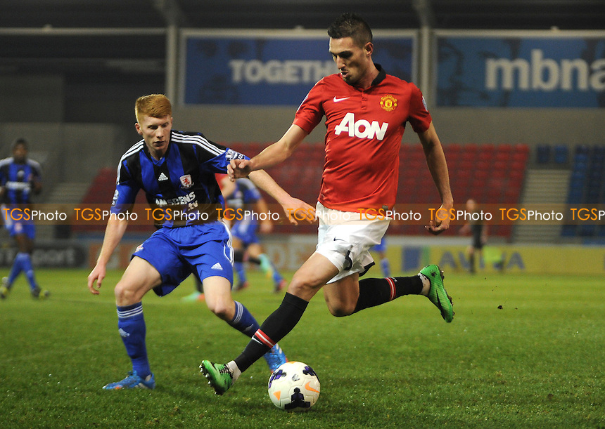Federico Macheda of Manchester United holds up the ball from Bradley Halliday of Middlesbrough - Manchester United Under-21 vs Middlesbrough Under-21 - Barclays Under-21 Premier League Football at Salford City Stadium, Manchester - 20/01/14 - MANDATORY CREDIT: Greig Bertram/TGSPHOTO - Self billing applies where appropriate - 0845 094 6026 - contact@tgsphoto.co.uk - NO UNPAID USE