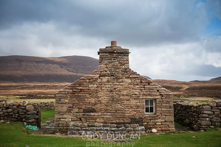 Old stone walls of Burnmouth Bothy, Rackwick Bay, Hoy, Orkney, Scotland