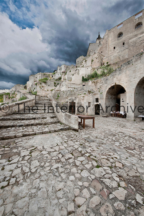 The cave hotel Le Grotte delle Civita is located in one of the oldest parts of the Sasso Barisano area of Matera, caves originally excavated for homes were restored into bedrooms alongside a communal area in an ancient church