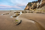 Hug Point State Park, Oregon: Colorful dawn sky at low tide