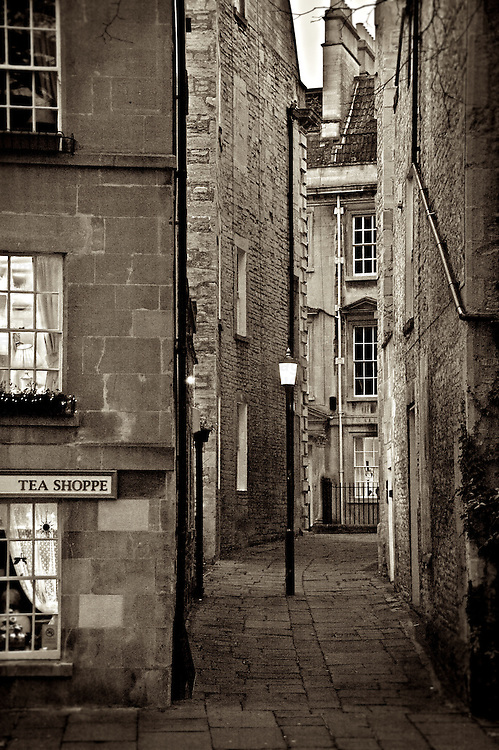 A narrow street at night in Bath, Somerset, England.
