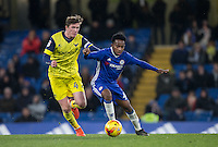 Goal scorer Josimar Quintero of Chelsea holds off John Lundstram of Oxford United during the The Checkatrade Trophy match between Chelsea U23 and Oxford United at Stamford Bridge, London, England on 8 November 2016. Photo by Andy Rowland.
