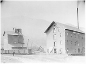 An early view of the Graden Flour Mill showing three D&amp;RGW box cars spotted on the loading track.<br /> D&amp;RG  Durango, CO  7/1886