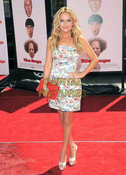 Becki Newton.The L.A. Premiere of 'The Three Stooges - The Movie' held at The Grauman's Chinese Theatre in Hollywood, California, USA..April 7th, 2012.full length white pink blue floral print dress clutch bag red hand on hip.CAP/RKE/DVS.©DVS/RockinExposures/Capital Pictures.