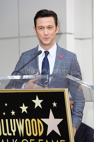 HOLLYWOOD, CA - OCTOBER 03: Joseph Gordon-Levitt poses as Actress Julianne Moore is honored with a star on the Hollywood Walk of Fame on October 3, 2013 in Hollywood, California. Credit: Sonboleh/RTN/MediaPunch Inc.