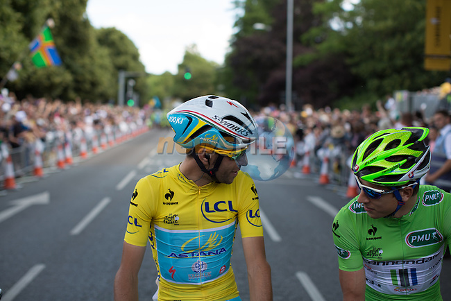 Race leader Yellow Jersey Vincenzo Nibali (ITA) Astana chats with Peter Sagan (SVK) Cannondale Green Jersey holder on the start line in Cambridge before the start of Stage 3 of the 2014 Tour de France running 155km from Cambridge to London. 7th July 2014.<br /> Picture: Brakethrough Media/www.newsfile.ie
