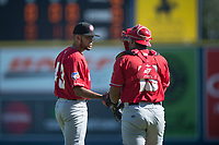 Vancouver Canadians starting pitcher Elio Silva (43) talks with catcher Yorman Rodriguez (13) during a Northwest League game against the Spokane Indians at Avista Stadium on September 2, 2018 in Spokane, Washington. The Spokane Indians defeated the Vancouver Canadians by a score of 3-1. (Zachary Lucy/Four Seam Images)