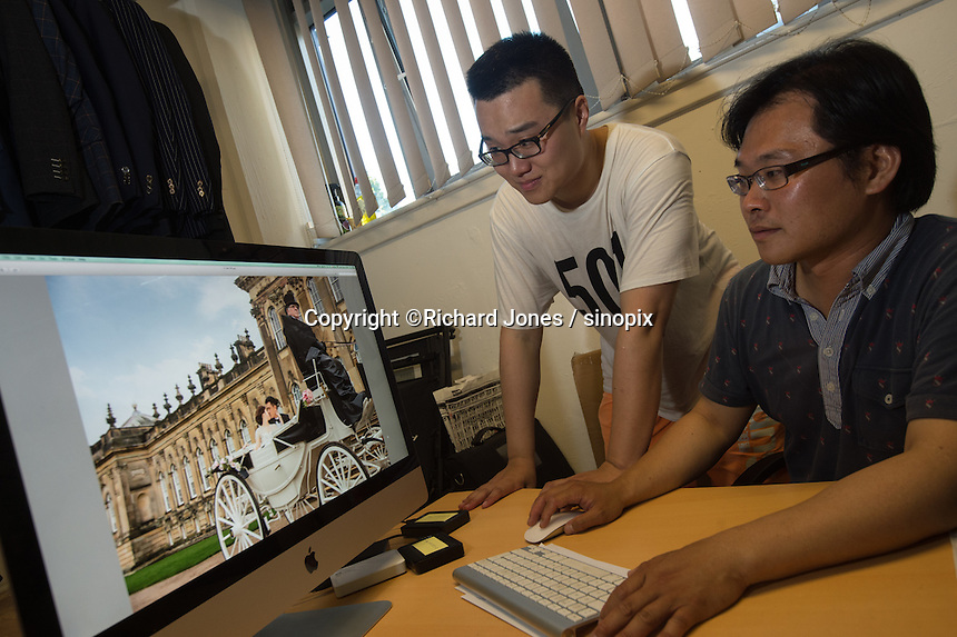 Zing (left) with Ray Wu, owner JR Studio in East London, UK, 19th July 2016, discuss pre-wedding photo options.