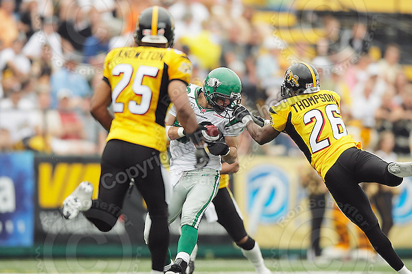 July 12, 2008; Hamilton, ON, CAN; Hamilton Tiger-Cats defensive back Chris Thompson (26) pulls the face mask of Saskatchewan Roughriders wide receiver Andy Fantuz (83) during the CFL football game at Ivor Wynne Stadium. The Roughriders defeated the Tiger-Cats 33-28. Mandatory Credit: Ron Scheffler.