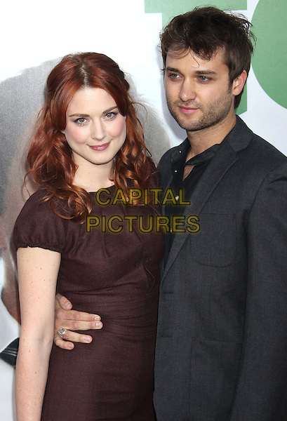 Alexandra Breckenridge & guest.The L.A. Premiere of 'Ted' held at The Grauman's Chinese Theatre in Hollywood, California, USA..June 21st, 2012.half length dress black brown arm around waist stubble facial hair grey gray.CAP/ADM/RE.©Russ Elliot/AdMedia/Capital Pictures.