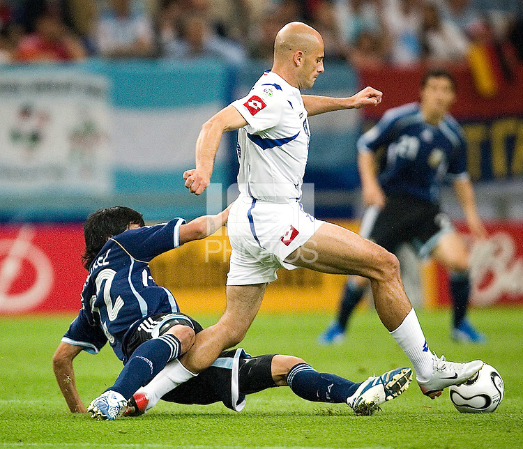 Predrag Djordjevic of Serbia & Montenegro in action against Luis Gonzalez of Argentina. Argentina defeated Serbia and Montenegro 6-0 in their FIFA World Cup Group C match at FIFA World Cup Stadium, Gelsenkirchen, Germany, June 16, 2006.