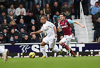 Barclays Premier League, West Ham United (red)V Swansea City Fc (white), Boelyn Ground, 02/02/13<br /> Pictured: Wayne Routledge slips past his marker, Matt Jarvis<br /> Picture by: Ben Wyeth / Athena Picture Agency<br /> info@athena-pictures.com