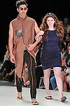 Graduating fashion student Alexandra Burns, walks runway with model at the close of the 2013 Pratt Institute Fashion Show, on April 25, 2013.
