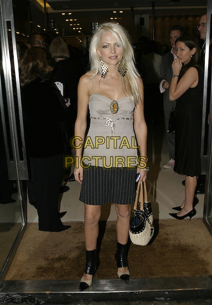 HANNAH SANDLING.MaxMara Flagship Store Opening Party, Old Bond Street, London, October 28th 2004..full length black pinstripe mini skirt  camisole vest top ribbon broach brooch.Ref: AH.www.capitalpictures.com.sales@capitalpictures.com.©Capital Pictures.