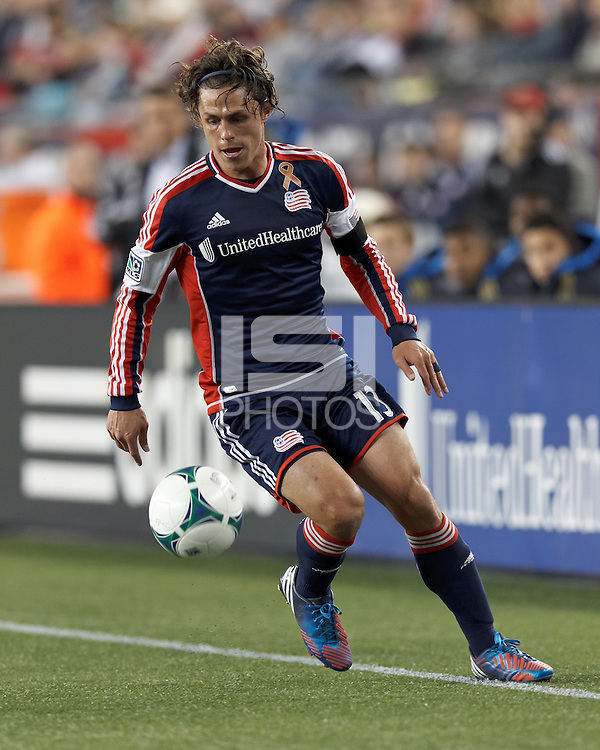 New England Revolution midfielder Ryan Guy (13) controls the ball.In a Major League Soccer (MLS) match, the New England Revolution (blue/red) defeated Philadelphia Union (blue/white), 2-0, at Gillette Stadium on April 27, 2013.