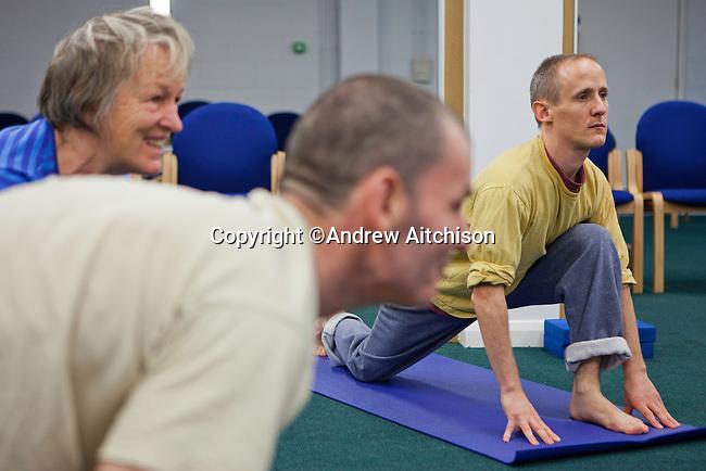 Prisoners and staff take part in a Yoga class run by the Prison Phoenix Trust. HMP Bullingdon, Oxfordshire.