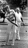 Basketball star Rick Barry playing golf with buddy George Martinovich. at the Sarah Coventry Golf Tournament in Alamo, Ca . (1977 photo by Ron Riesterer)