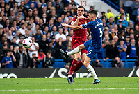Jordan Henderson of Liverpool and Jorginho of Chelsea during the Premier League match between Chelsea and Liverpool at Stamford Bridge, London, England on 22 September 2019. Photo by Liam McAvoy / PRiME Media Images.