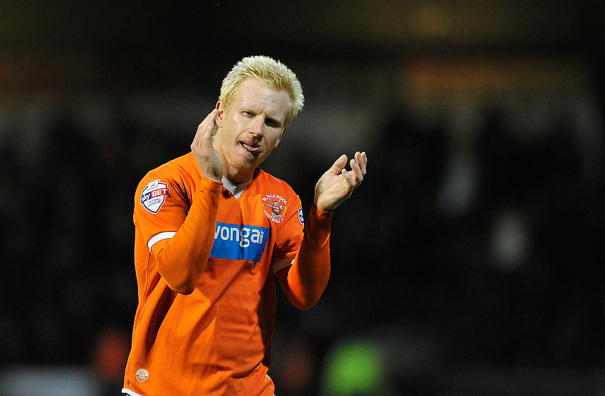 Blackpool's David Perkins applauds the travelling support after the 4-0 defeat to Brentford<br /> <br /> Photographer Ashley Western/CameraSport<br /> <br /> Football - The Football League Sky Bet League One - Brentford v Blackpool - Tuesday 24th February 2015 - Griffin Park - London<br /> <br /> &copy; CameraSport - 43 Linden Ave. Countesthorpe. Leicester. England. LE8 5PG - Tel: +44 (0) 116 277 4147 - admin@camerasport.com - www.camerasport.com