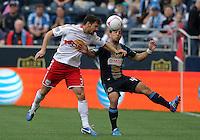 CHESTER, PA - OCTOBER 27, 2012:  Danny Cruz (44) of the Philadelphia Union clashes with  Heath Pearce (3) of the New York Red Bulls during an MLS match at PPL Park in Chester, PA. on October 27. Red Bulls won 3-0.