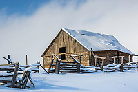 An old barn all dressed up in a new blanket of snow in Felt Idaho.