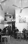 Sabra. The elder come together to smoke the waterpipe or &quot;Nargeeleh&quot;. This is the caf&eacute; &quot;Abu Nader Al Salhan&quot; in Sabra street.<br />  <br /> Sabra. Les anciens se retrouvent parfois au caf&eacute; pour fumer le narguil&eacute;. Ici au caf&eacute; &laquo;Abou Nader Al Salhan&raquo; dans la rue Sabra.